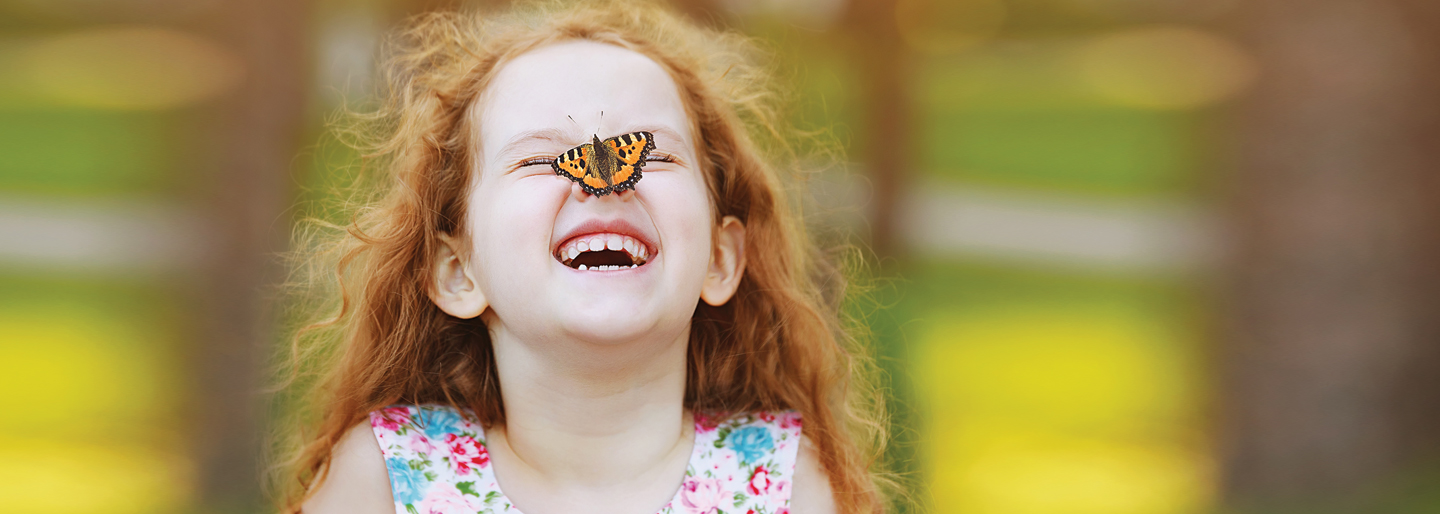 Girl with a butterfly on her nose.