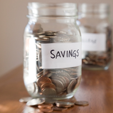 image of coins in jar with the word savings on the jar
